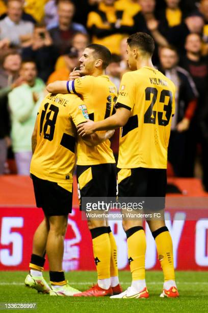 Morgan Gibbs-White of Wolverhampton Wanderers celebrates with teammates after scoring his team's fourth goal during the Carabao Cup Second Round...