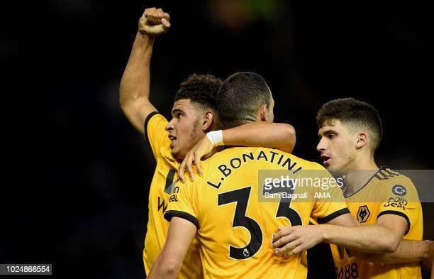 Morgan GibbsWhite of Wolverhampton Wanderers celebrates with Leo Bonatini of Wolverhampton Wanderers after scoring a goal to make it 01 during the...