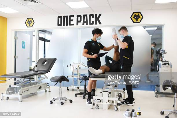 Morgan Gibbs-White of Wolverhampton Wanderers has his measurements taken as part of physio screening by Ollie Leaper, Physio of Wolverhampton...