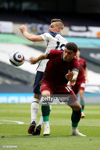 Morgan Gibbs-White of Wolverhampton Wanderers is challenged by Giovani Lo Celso of Tottenham Hotspur during the Premier League match between...