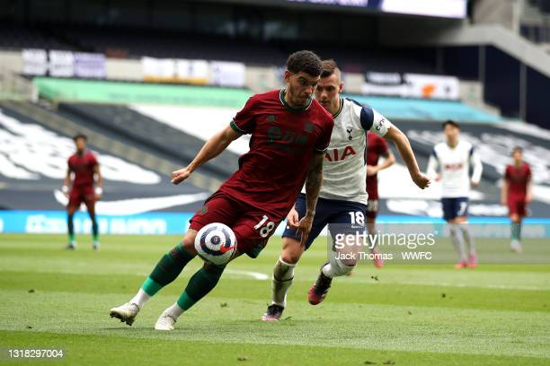 Morgan Gibbs-White of Wolverhampton Wanderers is closed down by Giovani Lo Celso of Tottenham Hotspur during the Premier League match between...