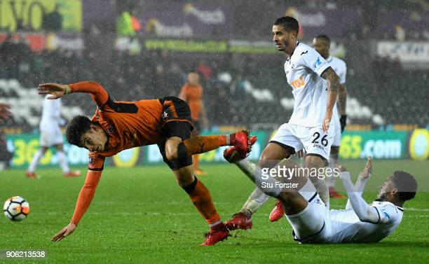 Morgan GibbsWhite of Wolverhampton Wanderers is tackled by Kyle Naughton of Swansea City and Leroy Fer of Swansea City during The Emirates FA Cup...