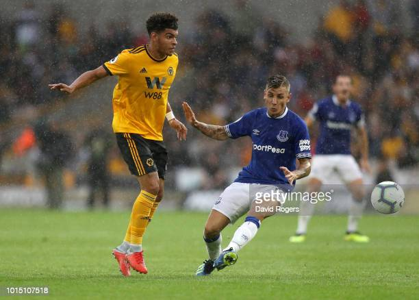 Morgan GibbsWhite of Wolverhampton Wanderers passes the ball under pressure from Lucas Digne of Everton during the Premier League match between...