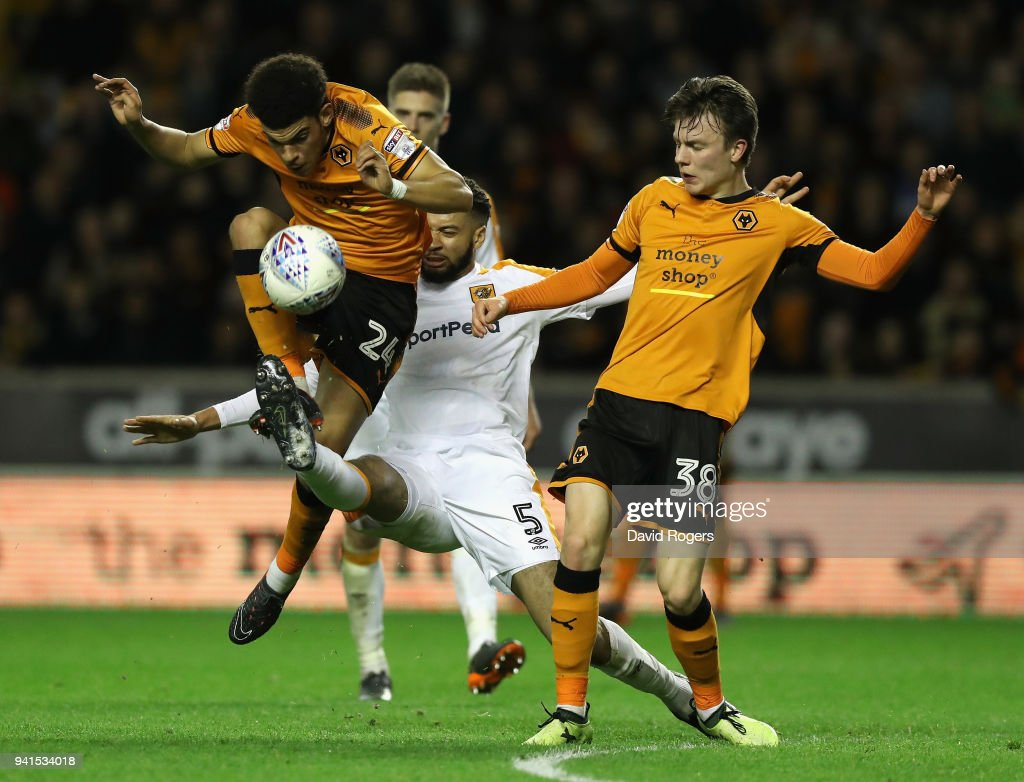 Morgan Gibbs-White (L) of Wolves is challenged by Michael Hector as team mate Oskar Buur Rasmussen looks on (R) during the Sky Bet Championship match between Wolverhampton Wanderers and Hull City at Molineux on April 3, 2018 in Wolverhampton, England.