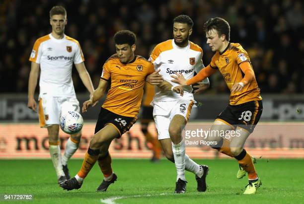 Morgan GibbsWhite of Wolves is challenged by Michael Hector as team mate Oskar Buur Rasmussen looks on during the Sky Bet Championship match between...