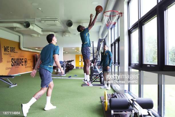 Morgan Gibbs-White, Owen Otasowie and Ki-Jana Hoever of Wolverhampton Wanderers play basketball in the gym at Sir Jack Hayward Training Ground as...
