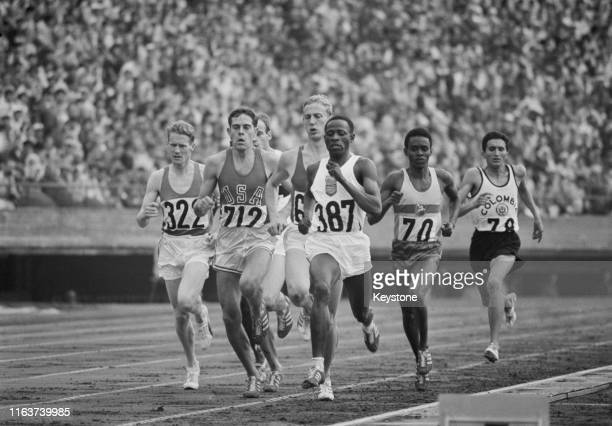 Morgan Groth of the United States, Peter Francis of Kenya and Derek McCleane of Ireland during Heat Three of the Men's 800 metres competition on 14th...