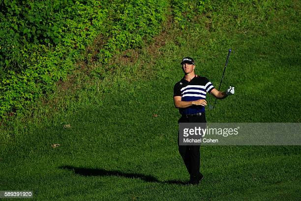 Morgan Hoffmann drops his club on the tenth hole during the third round of the John Deere Classic at TPC Deere Run on August 13 2016 in Silvis...