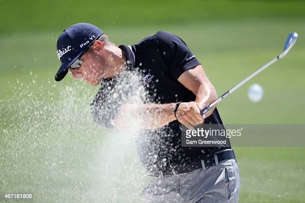 Morgan Hoffmann of the United States hits an approach shot from a bunker on the first hole during the third round of the Arnold Palmer Invitational...
