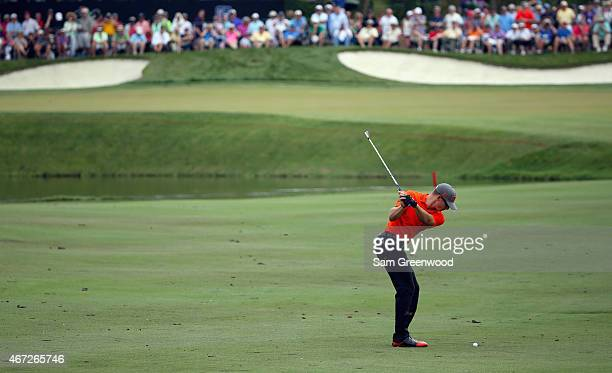 Morgan Hoffmann of the United States hits an approach shot on the eighth hole during the final round of the Arnold Palmer Invitational Presented By...