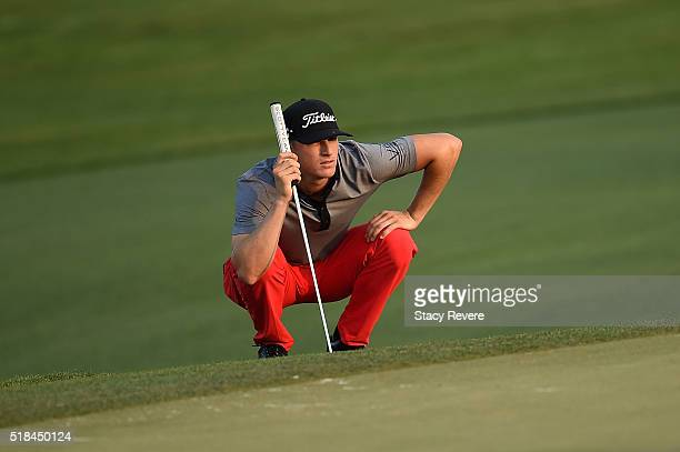 Morgan Hoffmann of the United States lines up a putt on the 18th green during the first round of the Shell Houston Open at the Golf Club of Houston...