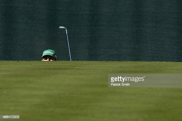 Morgan Hoffmann plays a shot on the 16th hole during the third round of the Waste Management Phoenix Open at TPC Scottsdale on February 1 2014 in...