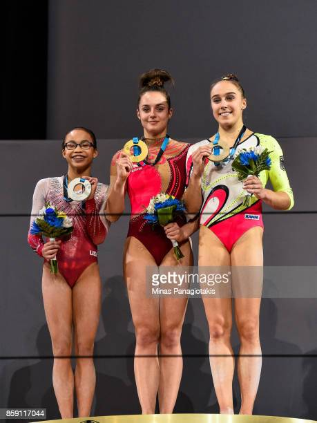 Morgan Hurd of The United States of America Pauline Schaefer of Germany and Tabea Alt of Germany pose with their medals after competing on the...