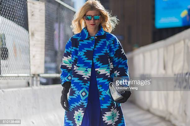 Morgan Hutchinson wearing a blue turquoise patterned coat long black gloves and blue wide pants seen outside Tadashi Shoji during New York Fashion...