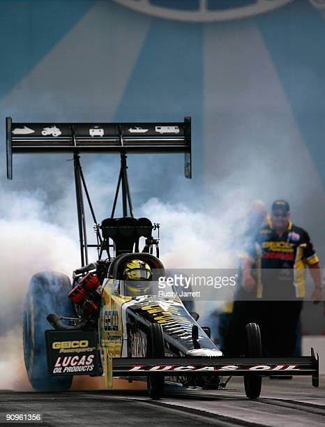 Morgan Lucas driver of the Geico/Lucas Oil top fuel dragster drives during first round qualifying for the NHRA Carolinas Nationals on September 18...