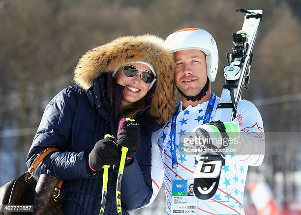 Morgan Miller greets her husband Bode Miller of the United States at the finish during training for the Alpine Skiing Men's Downhill during the Sochi...