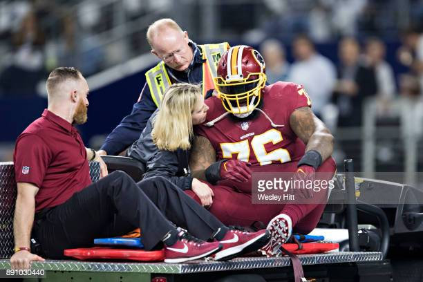 Morgan Moses of the Washington Redskins is carted off the field after suffering a injury during a game against the Dallas Cowboys at ATT Stadium on...