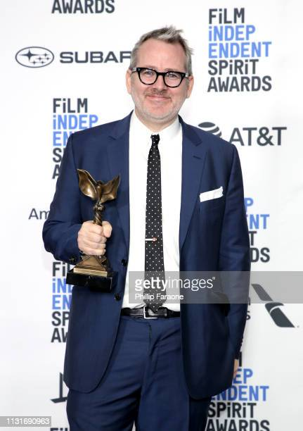 """Morgan Neville poses in the press room with the Best Documentary award for the film """"Won't You Be My Neighbor"""" during the 2019 Film Independent..."""