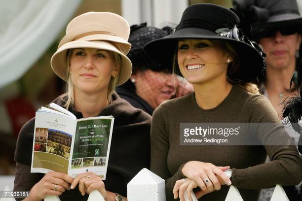 Morgan Norman daughter of golfer Greg Norman and girlfriend of Sergio Garcia and Emma Lofgren girlfriend of Henrik Stenson smile during the Ryder Cup...