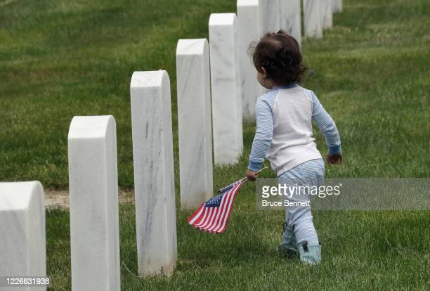 Morgan of Ronkonkoma walks through Calverton National Cemetery while visiting her grandfather's grave on May 23 2020 in Wading River New York Health...