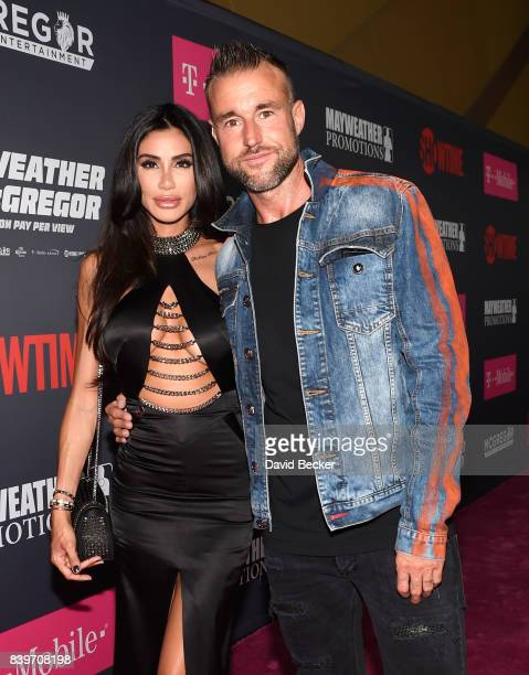 Morgan Osman and fashion designer Philipp Plein arrive on TMobile's magenta carpet duirng the Showtime WME IME and Mayweather Promotions VIP PreFight...