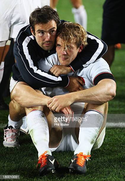 Morgan Parra consoles team mate Aurelien Rougerie of France during the 2011 IRB Rugby World Cup Final match between France and New Zealand at Eden...