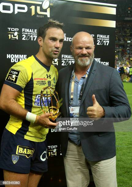 Morgan Parra of ASM Clermont receives from Chef Philippe Etchebest the trophy of 'best player of the match' following the Top 14 final match between...