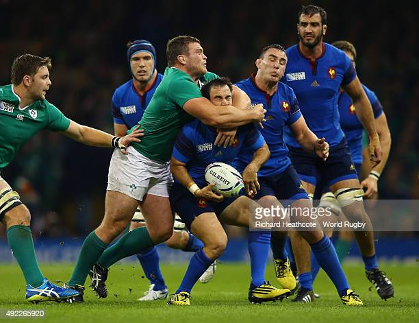 Morgan Parra of France is high tackled by Jack McGrath of Ireland during the 2015 Rugby World Cup Pool D match between France and Ireland at...