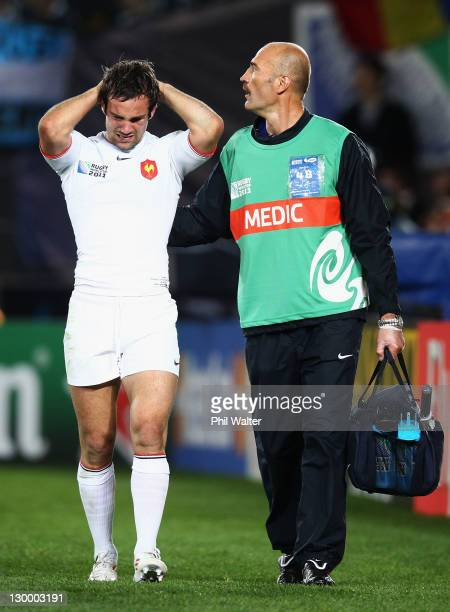 Morgan Parra of France looks dejected as he leaves the field injured during the 2011 IRB Rugby World Cup Final match between France and New Zealand...