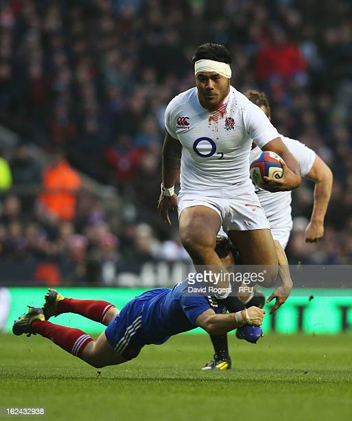 Morgan Parra of France tackles Manu Tuilagi of England during the RBS Six Nations match between England and France at Twickenham Stadium on February...