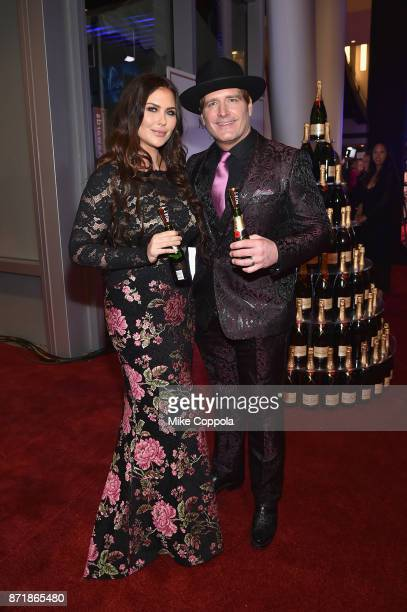 Morgan Petek Niemann and Jerrod Niemann pose with Moet Chandon during the 51st Annual CMA Awards at Bridgestone Arena on November 8 2017 in Nashville...