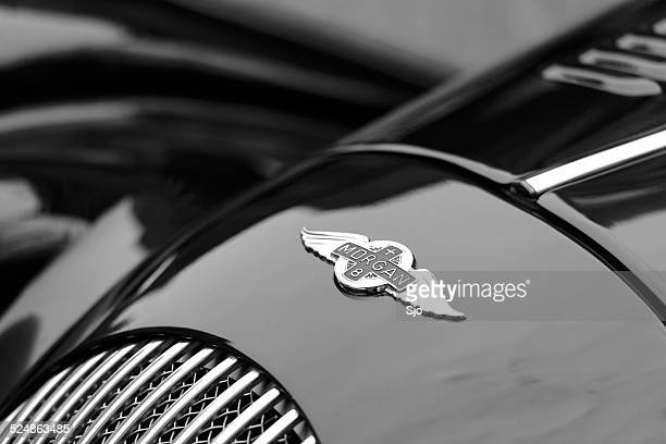morgan plus 8 sports car detail with the morgan logo - british culture stock pictures, royalty-free photos & images