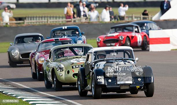 Morgan Plus Four leading 1958 MGA TwinCam Le Mans Fordwater Trophy race at The Goodwood Revival Meeting 15th Sept 2013