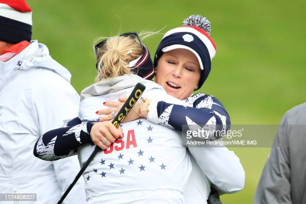 Morgan Pressel of Team USA hugs teammate Lexi Thompson after winning her match on the seventeenth hole during Day 2 of the Solheim Cup at Gleneagles...