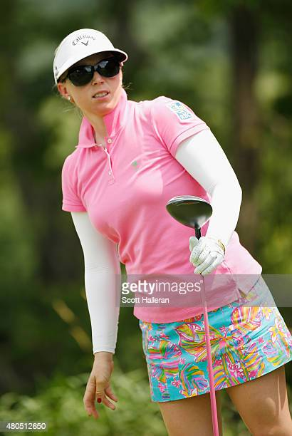 Morgan Pressel of the United States watches her tee shot on the second hole during the final round of the U.S. Women's Open at Lancaster Country Club...