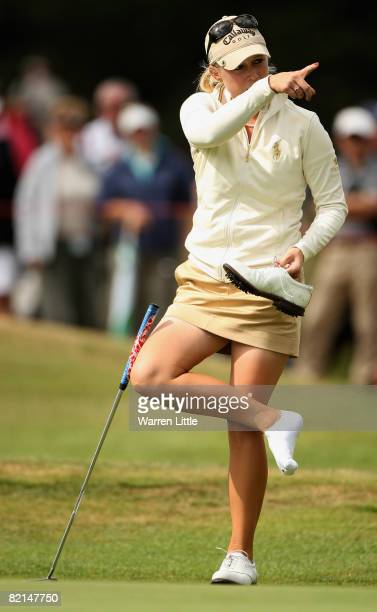 Morgan Pressel of the USA takes off her shoe on the 15th green during the second round of the 2008 Ricoh Women's British Open held on the Old Course...