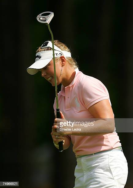 Morgan Pressel of USA reacts to missing a putt on the 7th hole during the completion of round two of the US Women's Open Championship at Pine Needles...