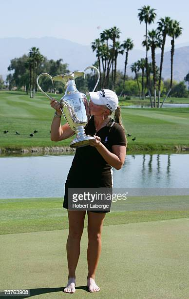 Morgan Pressel poses with the Dinah Shore Trophy after winning the LPGA Kraft Nabisco Championship at the Mission Hills Country Club on April 1 2007...