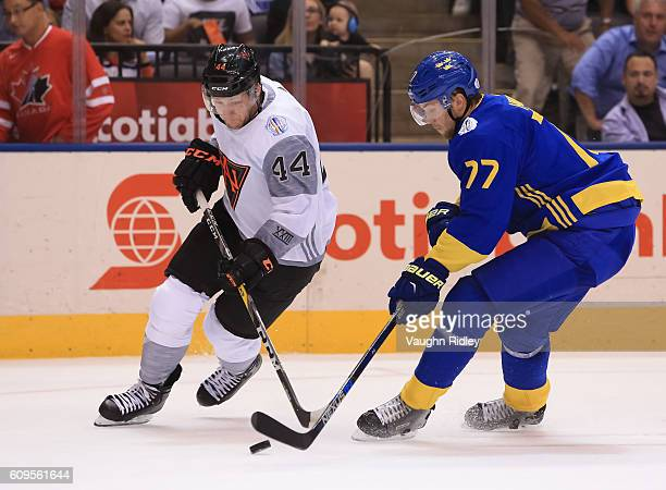 Morgan Rielly of Team North America battles for the puck with Victor Hedman of Team Sweden during the World Cup of Hockey 2016 at Air Canada Centre...