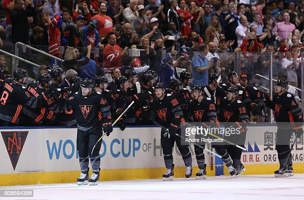 Morgan Rielly of Team North America high fives the bench after scoring a second period goal on Team Russia during the World Cup of Hockey 2016 at Air...