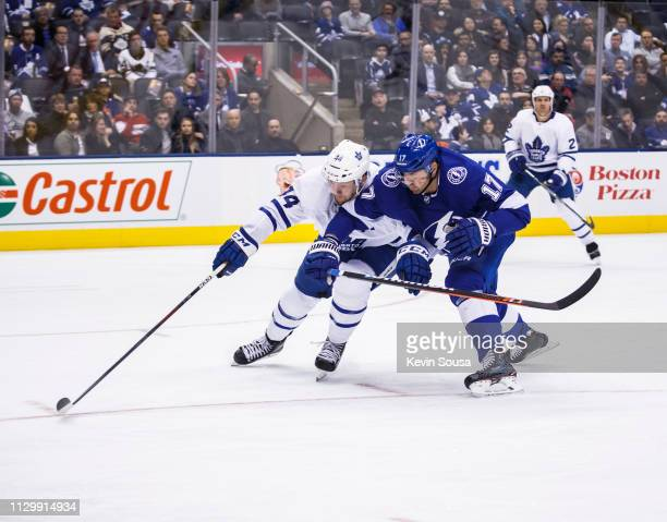 Morgan Rielly of the Toronto Maple Leafs battles against Alex Killorn of the Tampa Bay Lightning during the third period at the Scotiabank Arena on...