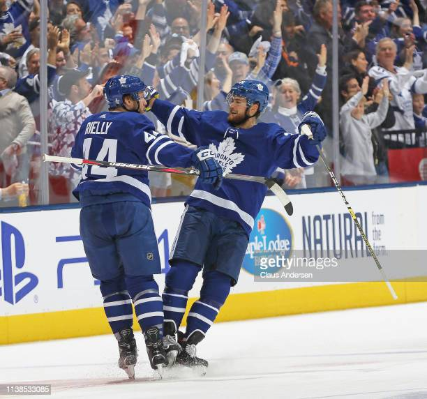 Morgan Rielly of the Toronto Maple Leafs celebrates a goal with teammate William Nylander against the Boston Bruins in Game Six of the Eastern...