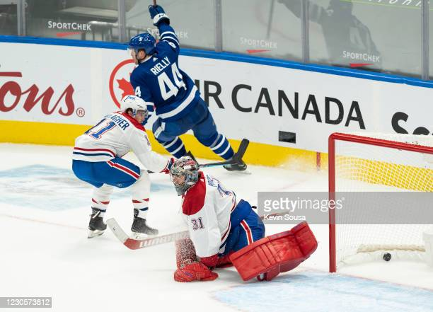 Morgan Rielly of the Toronto Maple Leafs celebrates his game winning overtime goal against Carey Price of the Montreal Canadiens at the Scotiabank...