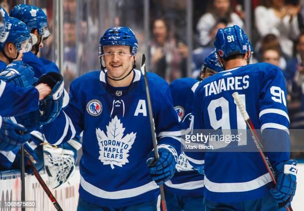 Morgan Rielly of the Toronto Maple Leafs celebrates his goal with the bench against the New Jersey Devils during the second period at the Scotiabank...