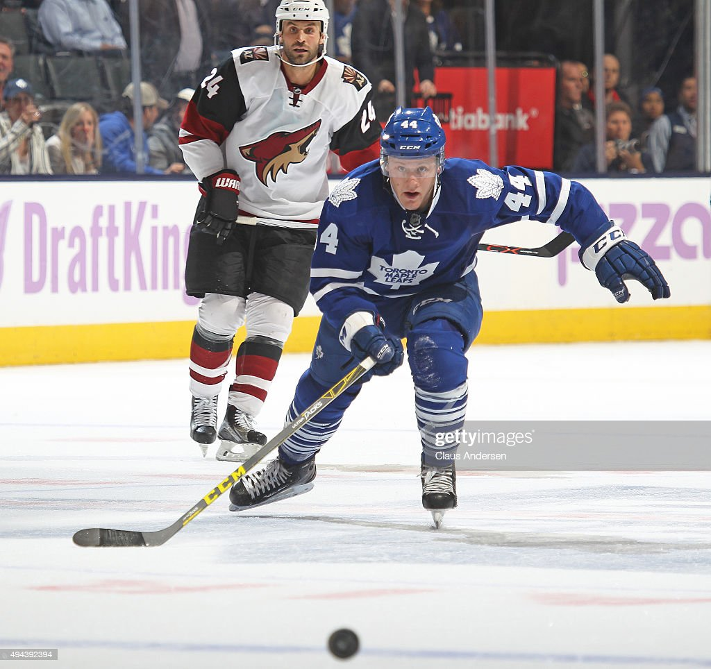 Morgan Rielly #44 of the Toronto Maple Leafs chases after a puck heading for an empty net against the Arizona Coyotes during an NHL game at the Air Canada Centre on October 26, 2015 in Toronto, Ontario, Canada. The Coyotes defeated the Leafs 4-3.