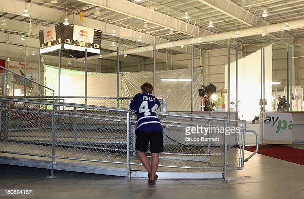 Morgan Rielly of the Toronto Maple Leafs chats on the phone during the media opportunity at the 2012 NHLPA rookie showcase at the MasterCard Centre...