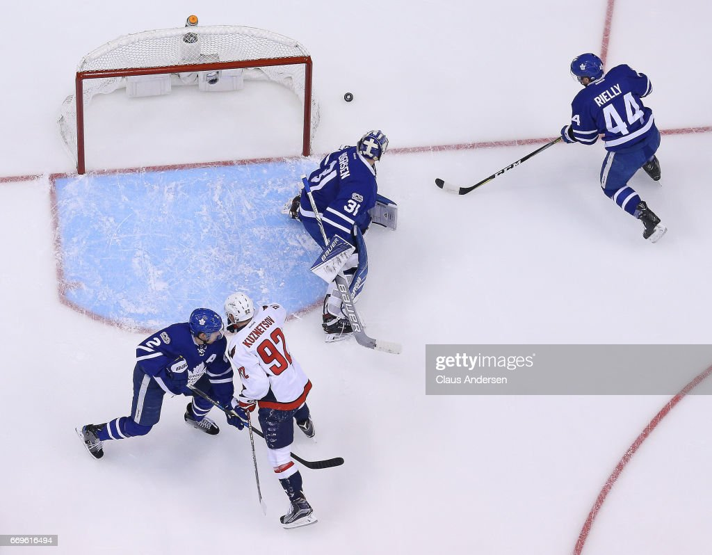Morgan Rielly #44 of the Toronto Maple Leafs grabs the puck for teammate Frederik Andersen #31 against the Washington Capitals in Game Three of the Eastern Conference Quarterfinals during the 2017 NHL Stanley Cup Playoffs at the Air Canada Centre on April 17, 2017 in Toronto, Ontario, Canada. The Maple Leafs defeated the Capitals 4-3 in overtime.