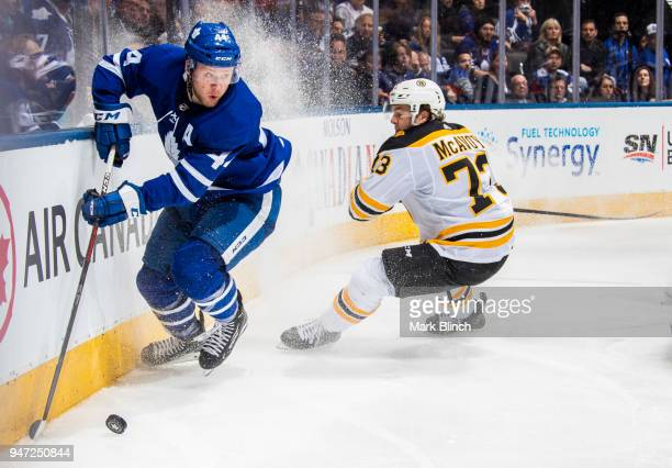 Morgan Rielly of the Toronto Maple Leafs skates against Charlie McAvoy of the Boston Bruins in Game Three of the Eastern Conference First Round...