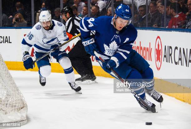 Morgan Rielly of the Toronto Maple Leafs skates against Nikita Kucherov of the Tampa Bay Lightning during the second period at the Air Canada Centre...