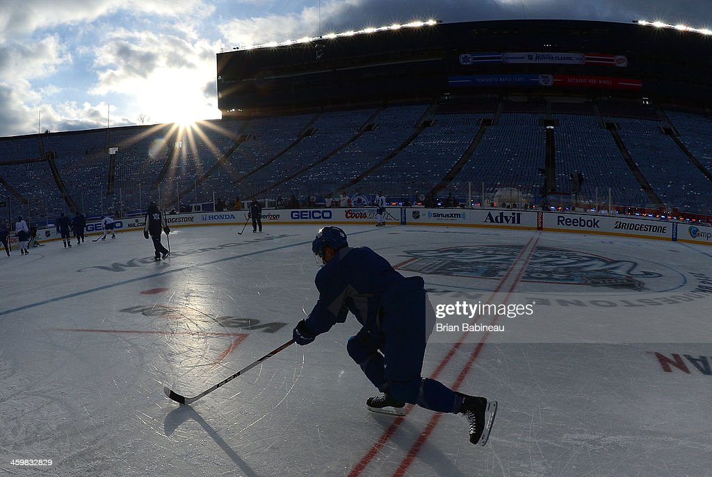 Morgan Rielly #44 of the Toronto Maple Leafs skates through center ice during the 2014 Bridgestone NHL Winter Classic team practice session on December 31, 2013 at Michigan Stadium in Ann Arbor, Michigan.